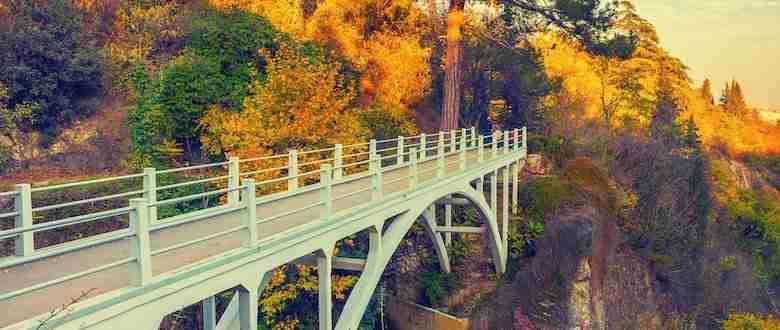 Bridge over cavern, autumn park
